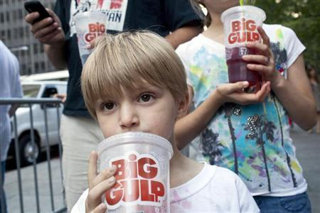 "Benjamin Lesczynski takes a sip of a ""Big Gulp"" while protesting the proposed ""soda-ban,"" that New York City Mayor Bloomberg has suggested, outside City Hall in New York"